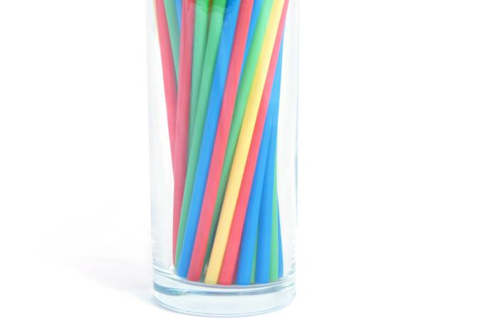 Cocktail straws in glass