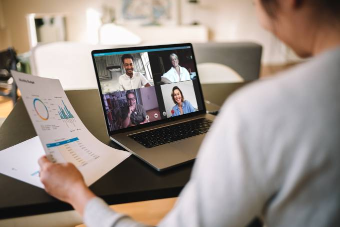 Businesswoman having online business meeting from home