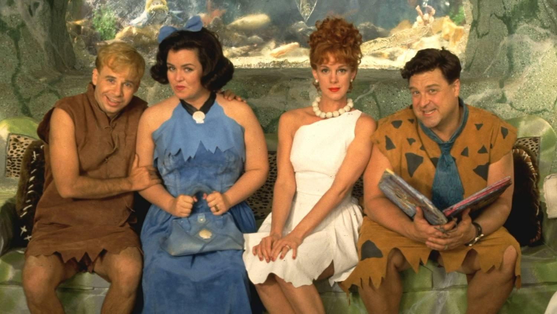 Atores do filme os Flintstones interpretando Barney, Betty, Wilma e Fred