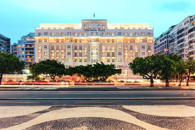 Copacabana Palace hotel and iconic black and white sidewalk pattern at night in Rio de Janeiro