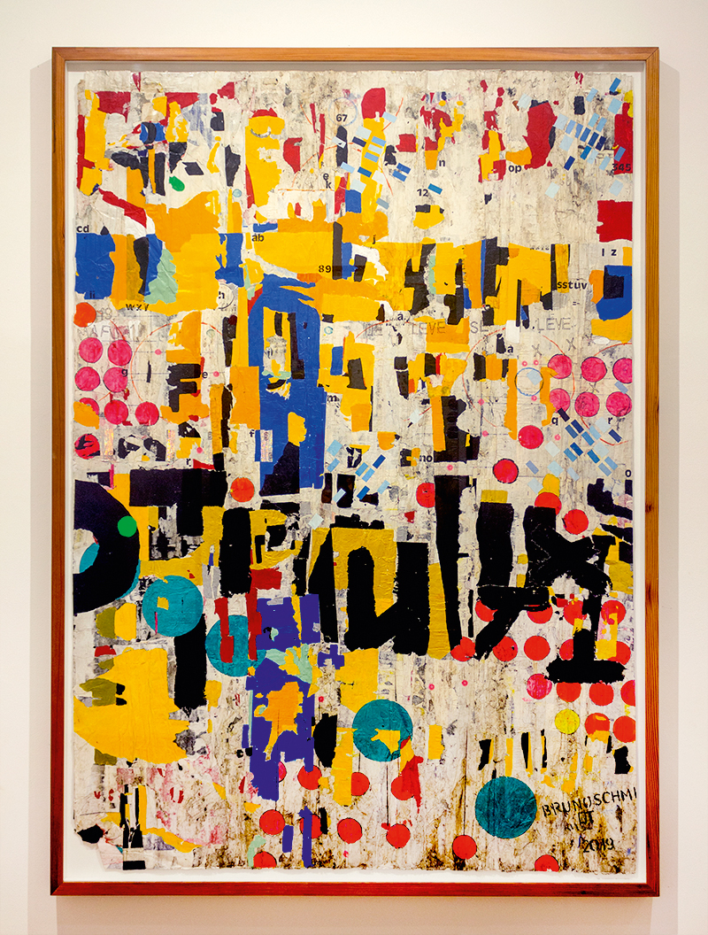 Quadro com colagem de páginas de revista em tons de azul, amarelo, preto e vermelho