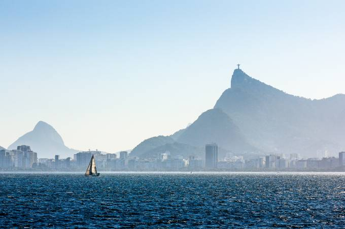 Sailing Boat Sailing in Guanabara Bay with Christ the Redeemer
