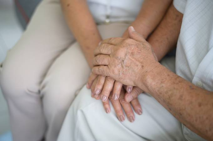 Close up of elderly hands holding each other , Grandfather hands is holding grandma hands , together , family concept