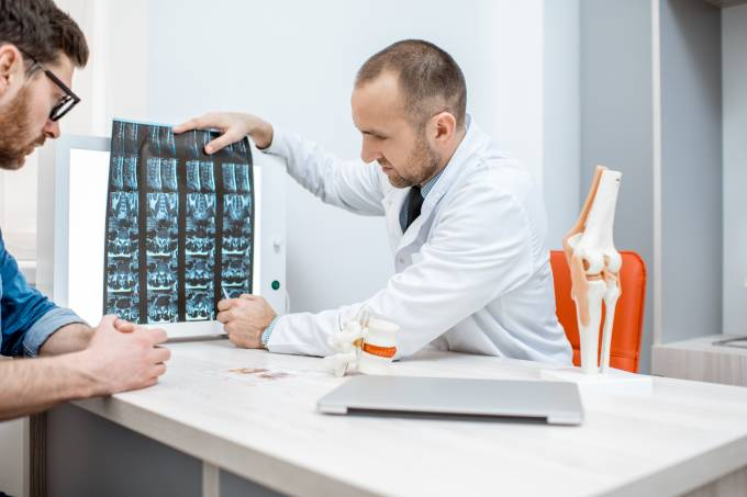 Man with therapist during the medical consultation