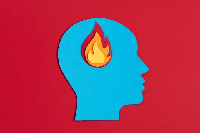 Papercut head with fire inside. Mental health problems, burnout, psychology, stress, mental illness