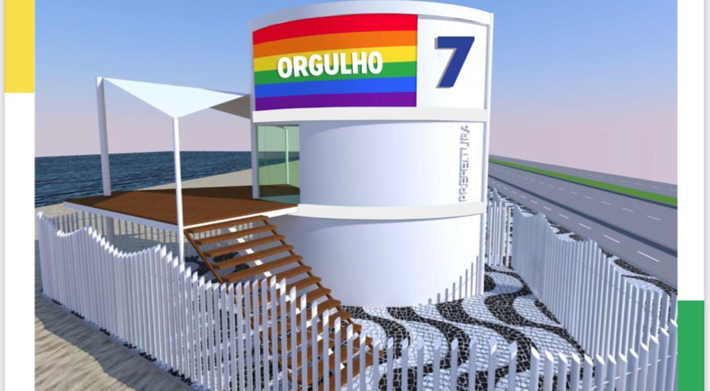 A imagem mostra um dos postos de salvamento da cidade com um painel que retrata a bandeira do arco-íris e a palavra Orgulho
