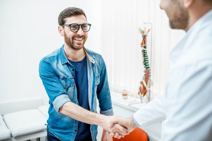 Patient handshaking with doctor at the office