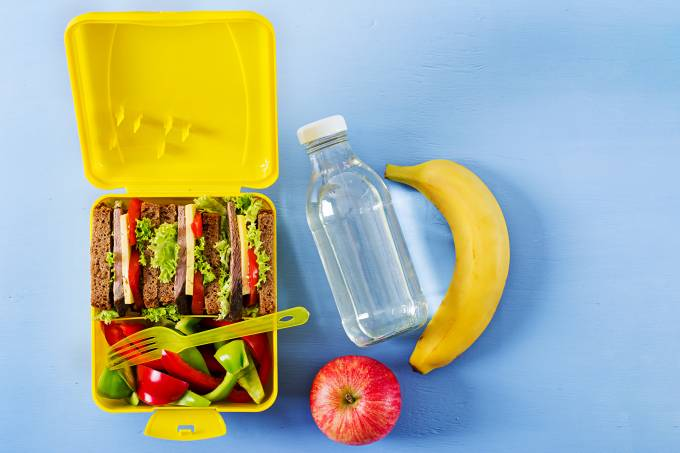 healthy-school-lunch-box-with-beef-sandwich-and-fresh-vegetables-bottle-of-water-and-fruits