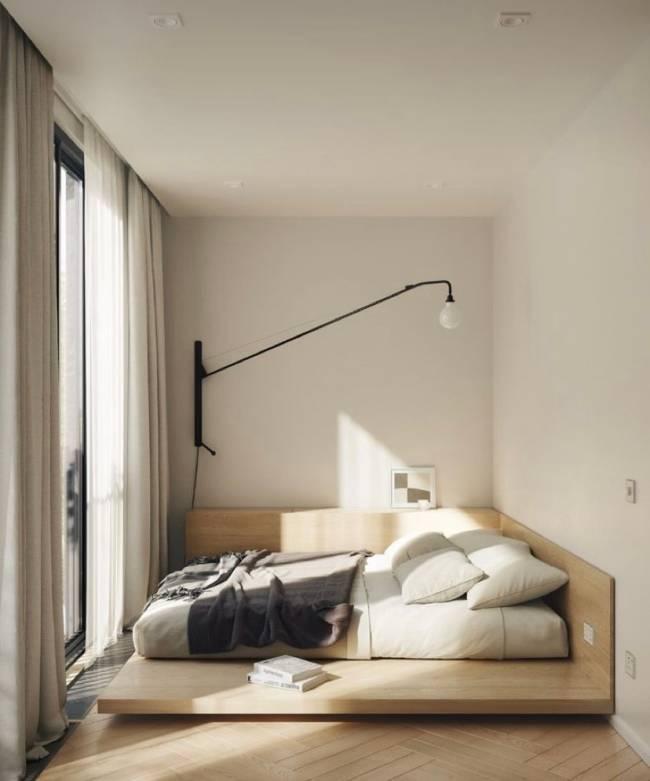 A imagem mostra um quarto com cama e luminaria moderna